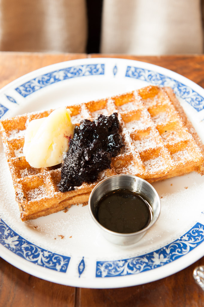 Waffle with blueberry jam and honey butter